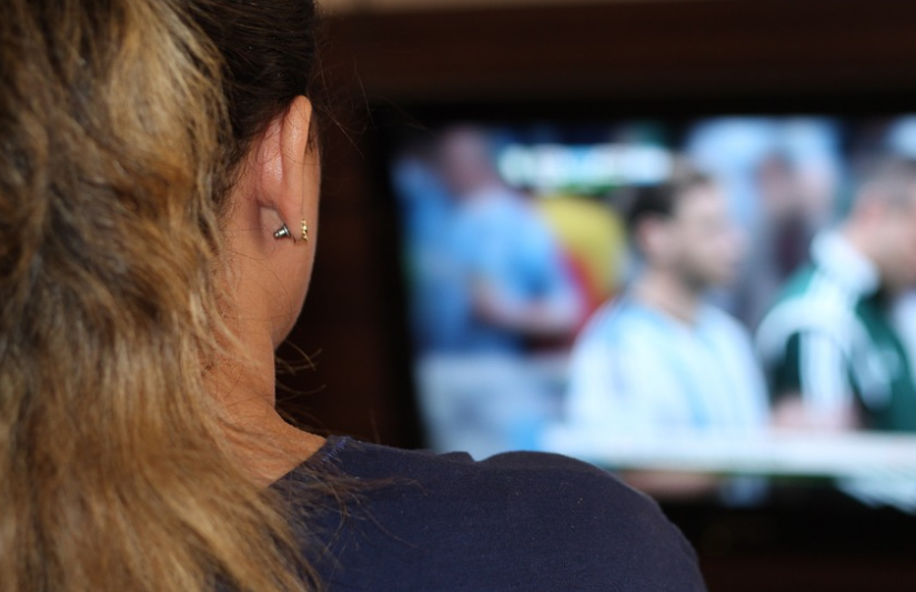 woman-sitting-in-front-of-tv